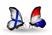 stock photo of holland flag  - Two butterflies with flags on wings as symbol of relations Finland and Holland - JPG
