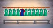 Row of Green and Blue Football Shirts 3-5