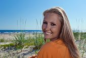 Happy Blond Woman On A Beach