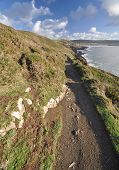 picture of southwest  - Southwest Coast footpath near Baggy Point headland looking back towards Croyde North Devon England - JPG