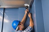 Cctv Technician Fixing Camera