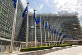 image of european  - European flags in front of headquarters of European commission in Brussels in summer day - JPG