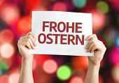 Happy Easter (in German) card with colorful background with defocused lights