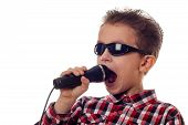 Boy Yelling In Microphone