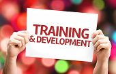 Training & Development card with colorful background with defocused lights