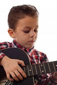 Boy Practicing Eith Guitar