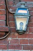 Old light on a brick wall