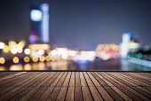 wooden platform and lights of night,shanghai china.