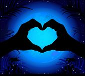picture of moon silhouette  - Silhouette of hands making a heart on a background of the night sky and the moon - JPG