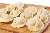 Dumplings On Cutting Board In Kitchen