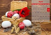 Easter Composition With Eggs And Flower Tulip In A Basket With A Calendar For April 2015