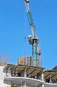 picture of formwork  - Crane hoisting formwork over construction site work - JPG