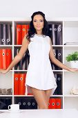 stock photo of provocative  - sexy provocative businesswoman in white dress at office - JPG