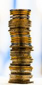 stock photo of copper coins  - macro view of coins stacked in a blurred background - JPG