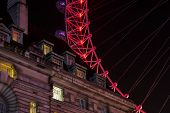 foto of london night  - Close up of London Eye behind a palace in the night - JPG