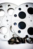 stock photo of mm  - 35 mm movie cinema reels with film unrolled vertical frame on white background - JPG