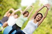 pic of pilates  - Group of people in a pilates class outdoors - JPG