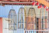 pic of trap  - Fish traps hanging outside of a house in Chew Jetty floating village in Georgetown Penang Malaysia - JPG
