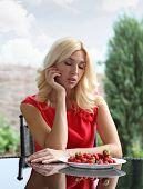 foto of strawberry blonde  - Blonde beautiful girl laughing eating and playing with fresh strawberry - JPG