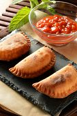 picture of patty-cake  - homemade tuna patty with tomato sauce on wooden table - JPG