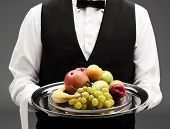 pic of fruit platter  - butler holding tray with assortment of fruits - JPG