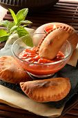 stock photo of patty-cake  - homemade tuna patty with tomato sauce on wooden table - JPG