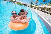 pic of swimming pool family  - Happy family having fun in the swimming pool - JPG