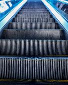 foto of escalator  - Looking up at multiple escalators outside building - JPG