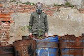 stock photo of nuclear disaster  - Man with gas mask and green military clothes after chemical disaster - JPG