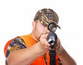 Hunter Pointing The Gun Towards The Camera