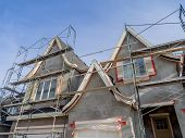 pic of scaffold  - Scaffolds surrounding home following application of smooth exterior stucco but prior to painting - JPG