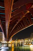 stock photo of calatrava  - The Constitution Bridge Venice at night vertical It is the fourth bridge over the Grand Canal and was designed by Calatrava and was moved into place in 2007 - JPG
