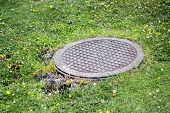 stock photo of manhole  - manhole cover in the middle of the mountains - JPG