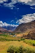 image of jammu kashmir  - Sceneic view of Drass village with blue cloudy sky background Kargil Ladakh Jammu and Kashmir India - JPG