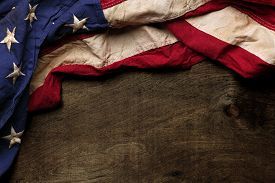 stock photo of memorial  - Old American flag background for Memorial Day or 4th of July - JPG