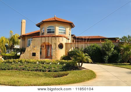 Spanish home with thick stucco and rounded edges. Enclosed patio