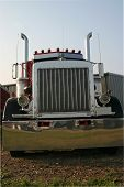 picture of semi-truck  - this is a picture of the front of a large semi truck taken at a low stance with a slight angle to give the feeling of movement and power - JPG