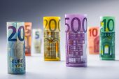 Постер, плакат: Several hundred euro banknotes stacked by value Rolls Euro banknotes Euro currency money