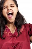 Beautiful Indian girl yawning