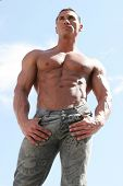 Male body builder with bluejeans