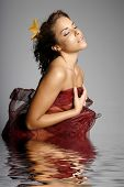 Sexy hispanic girl in water