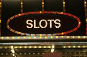 picture of slot-machine  - Neon slots sign - JPG