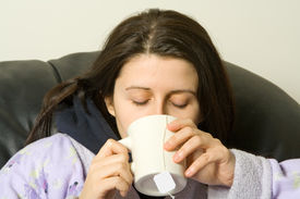 pic of cold drink  - woman with a cold drinking a hot tea - JPG