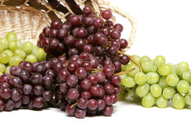stock photo of wine grapes  - Red and green grapes in basket - JPG