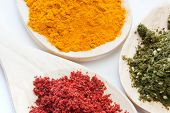 pic of hyssop  - Mixed spices in different colors on wooden spoons - JPG