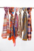 Many Colorful scarves on hanger