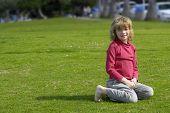 Happy Child On Grass.