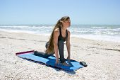 Woman Doing Yoga Exercise Low Lunge Pose On Beach