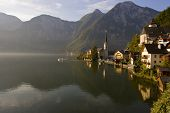 Boat Sailing Into The Morning Fog In Hallstatt, Austria