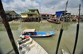 fishing boats and wooden houses in the fishing village